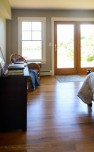 New hardwood floors, window and door in third bedroom