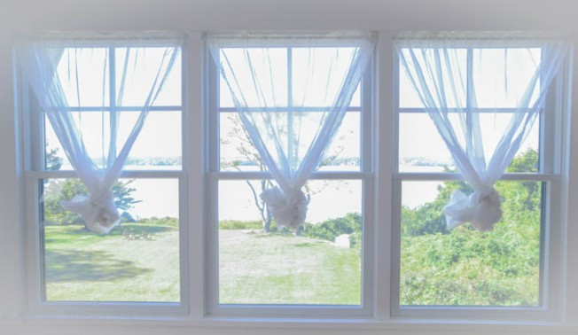 Windows in first bedroom overlooking bay